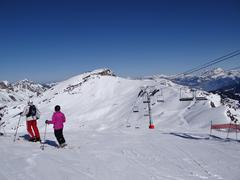 Skiers prepare to descend the piste Stock Photos