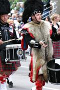 kilted drummer in marching band - stock photo