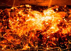 Abstract background of burning coals of fire with sparks Stock Photos