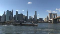 Barge and lower Manhattan - stock footage