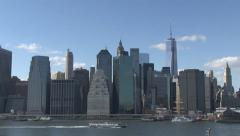 Lower Manhattan  and a tourist boat. Stock Footage