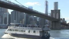 NY watertaxi sails under Brooklyn Bridge. Stock Footage