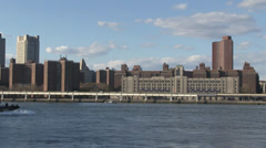 A tug sails towards Manhattan Bridge, New York City. Stock Footage