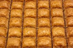traditional turkish baklava (sweet dessert made of thin pastry, nuts and hone - stock photo
