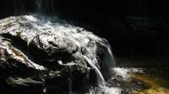 Waterfall on rock at Tham Yai Waterfall Stock Footage