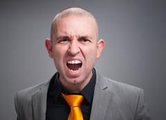 Businessman angry and shouting Stock Photos