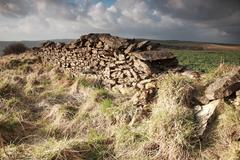 Sunlit dry stone wall Stock Photos