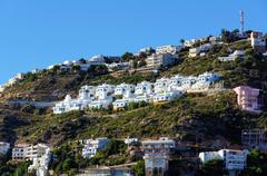 Mediterranean vacation houses on a hill Stock Photos