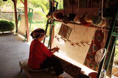 Woman weaving a turkish rug Stock Photos