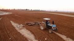 Tractor plowing the fild Stock Footage