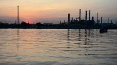Boat in the river with oil refinery background in the morning Stock Footage
