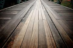 old wooden road on the metal bridge, thailand - stock photo