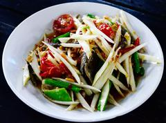 green papaya salad with salted crab in thai style - stock photo