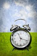 alarm clock in retro style - stock photo