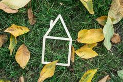 model house made on green grass - stock photo