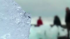 Blue shimmering ice block at icelandic coast Stock Footage
