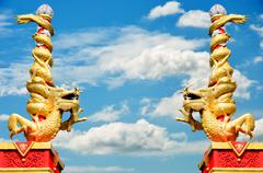 dragon statue roll the column with blue sky - stock photo