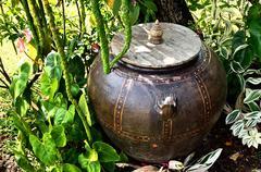 Stock Photo of retro jar under tree