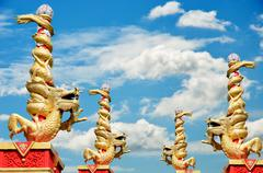 Stock Photo of dragon statue roll the column with blue sky