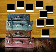 Retro travel concept, Old travel bags with photo frames post on wooden wall Stock Illustration