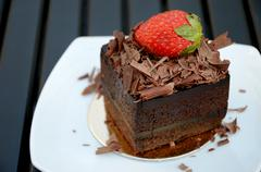 Stock Photo of chocolate cake with strawberry on the white plate