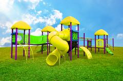 Stock Photo of Children s playground in garden with nice sky background