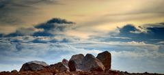 rock with cloud background - stock photo