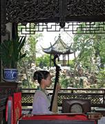 Suzhou, china - july 20, 2007: young woman plays pipa at a free show for tour Stock Photos