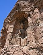 one of the numerous buddha reliefs of the yungang grottoes, china - stock photo