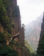 Hazardous pathway over the precipice in huang shan, china Stock Photos
