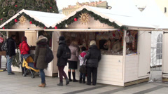 Annual christmas fair town with white kiosk row and people Stock Footage