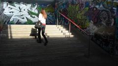 Few woman walk stairs in city underground dark passage subway Stock Footage