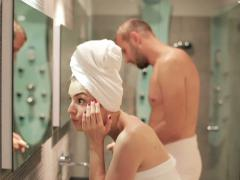 Young couple preparing in front of the mirror in bathroom NTSC - stock footage