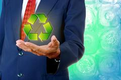 Stock Illustration of Senior businessman handheld recycle symbol, Sustainability business concept