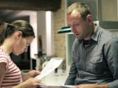 Stock Video Footage of Sad young couple reading payment bills in the kitchen NTSC