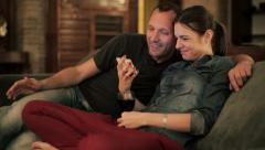Young couple watching something funny on smartphone at home HD - stock footage
