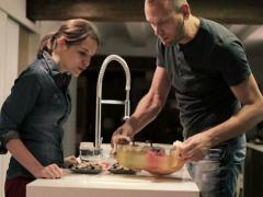 Couple taking ready, hot food from oven in the kitchen NTSC Stock Footage