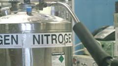 Pan from laboratory nitrogen tank to LCD control panel display Stock Footage