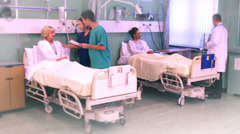 Time lapse of medical staff taking care of patients on a busy hospital ward - stock footage