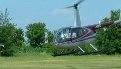 Robinson R44 helicopter take off Stock Footage