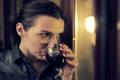 Sad, beautiful woman drinking wine by the window at night NTSC Footage