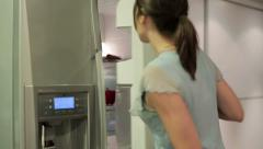 Young woman taking food from the fridge HD Stock Footage