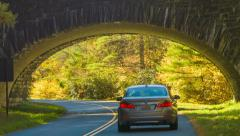 Passenger Vehicle Driving Under Blue Ridge Parkway Bridge - stock footage