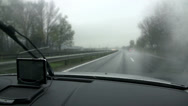 Stock Video Footage of View through car's windscreen on a cloudy and rainy day