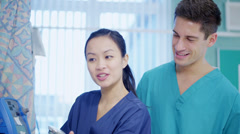 Caring medical workers at the bedside of an elderly female patient. Stock Footage