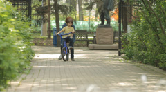 Mom Teaching Child to Ride a Bike Stock Footage