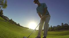 Golfer Hitting Chip Shot Over Camera - Slow Motion Stock Footage