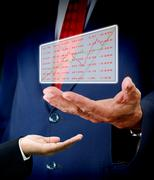 Stock Illustration of Stock exchange analysis data in senior hand