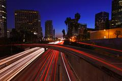 Timelapse image of los angeles freeways at sunset Stock Photos