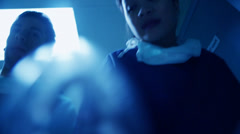 Medical staff transport a patient in serious condition on a hospital gurney Stock Footage